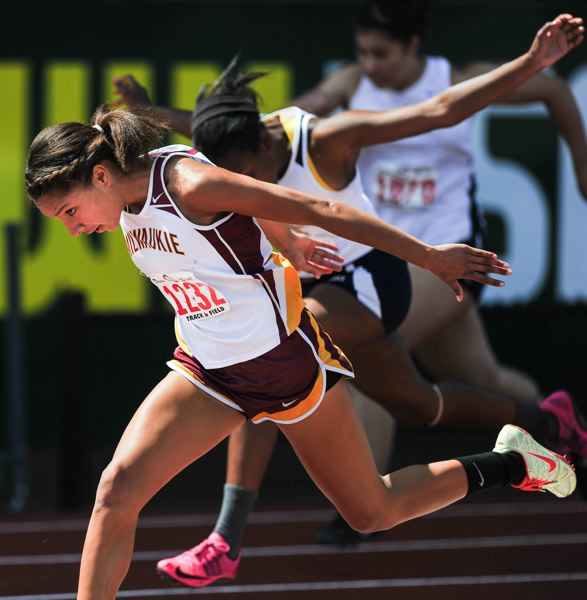 by: JOHN LARIVIERE - Milwaukie High School sophomore Tieara Norman flies to a state championship victory in the high hurdles in Saturday afternoons finals at Hayward Field.