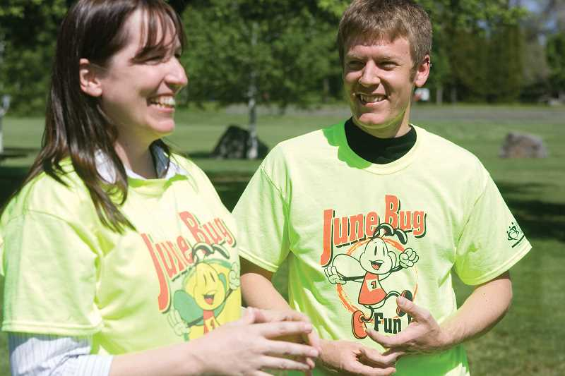 by: KEVIN SPERL - Jeremy Anderson, RIGHT, talks with Donna Hamlin at the start of their upcoming June Bug Fun Run.