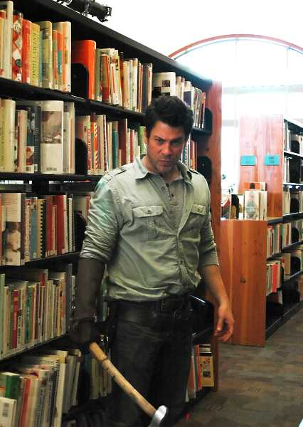 by: ISABEL GAUTSCHI - Christian Kane pauses between filming scenes for 'The Librarians' at the Estacada Public Library on Monday, May 19. Kane ('Leverage,' 'Angel') stars as a brilliant Oklahoma oil worker with extensive knowledge of art history.