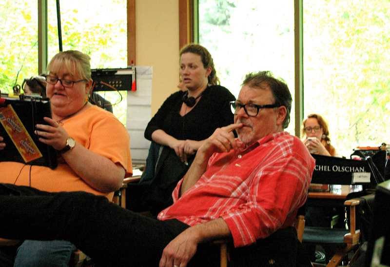 by: ISABEL GAUTSCHI - Jonathan Frakes is directing the third episode of 'The Librarians.' He observes from the director's chair in the Estacada Public Library on Monday, May 19. Frakes is renowned for his role as Cmdr. Riker in 'Star Trek: The Next Generation.'