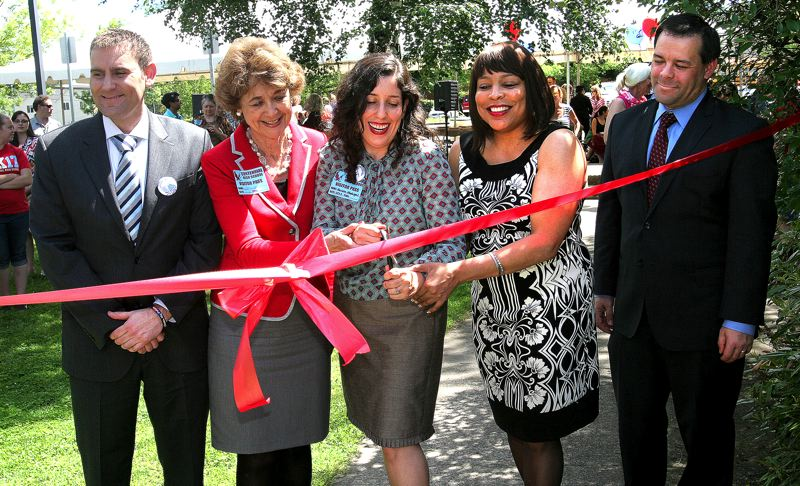 by: OUTLOOK PHOTO: JIM CLARK - Multnomah County Commission Chairwoman Marissa Madrigal (center) officially cut the ribbon to formally open the center, assisted by commissioners Diane McKeel (left) and Loretta Smith (right). Also present were Centennial High School Principal Kevin Ricker (far left) and Sam Breyer, district superintendent.