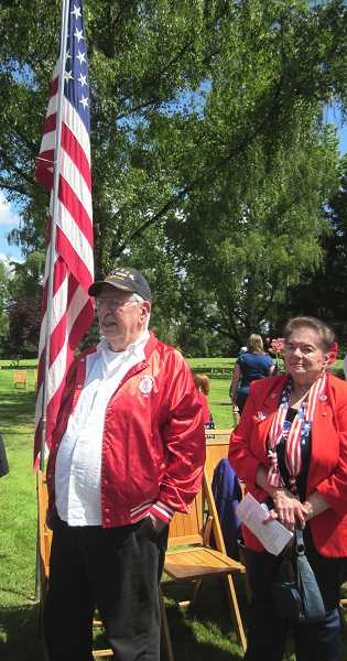 by: TIMES PHOTO: BARBARA SHERMAN - Attending the Tigard Memorial Day ceremony is veteran Everett Smail of Tigard, who served in the Marines from 1952 to 1954, and standing beside him is patriotically dressed Nora Pirrie.
