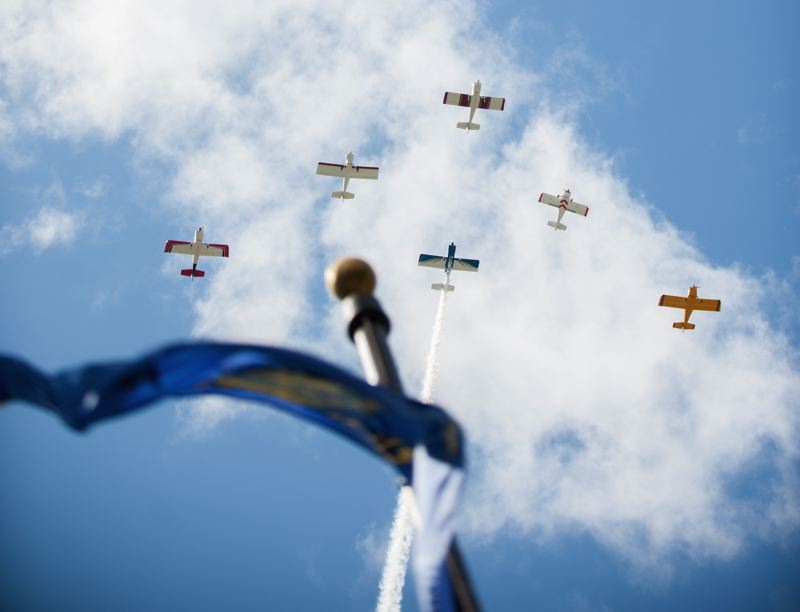 by: SPOKESMAN PHOTO: JOSH KULLA - Aircraft flying out of Aurora perform a flyover Monday in Wilsonville, part of a Memorial Day commemoration hosted by the Oregon Trail Chapter of the Korean War Veterans Association.