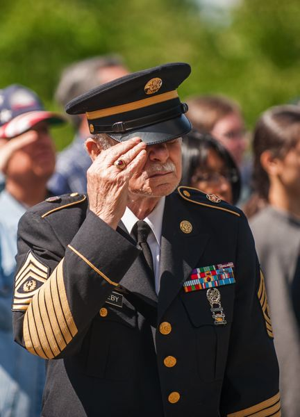 by: SPOKESMAN PHOTO: JOSH KULLA - A U.S. Army veteran is shown Monday at a Memorial Day commemoration in Wilsonville.