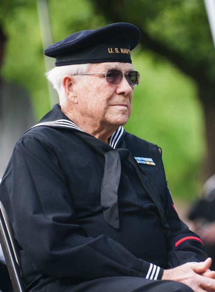 by: SPOKESMAN PHOTO: JOSH KULLA - A U.S. Navy veteran attends the Memorial Day commemoration in Wilsonville.