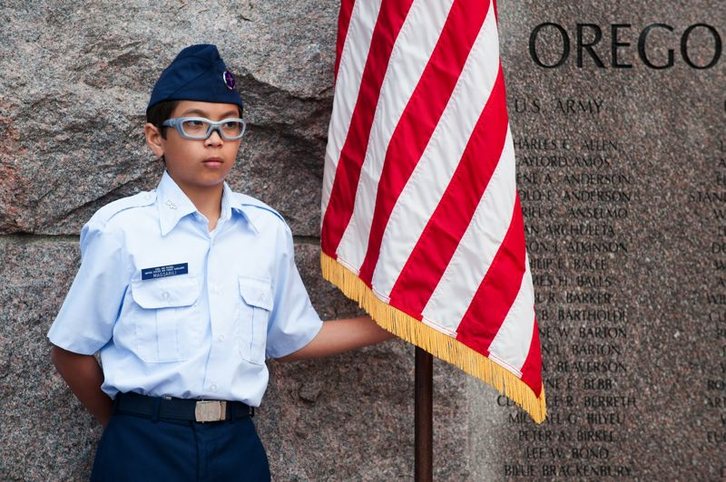 by: SPOKESMAN PHOTO: JOSH KULLA - An Aurora Squadron Civil Air Patrol member shown Monday at a Memorial Day commemoration in Wilsonville.