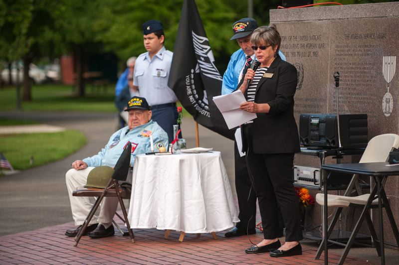 by: SPOKESMAN PHOTO: JOSH KULLA - Wilsonville City Council Julie Fitzgerald speaks Monday at a Memorial Day ceremony at Town Center Park.