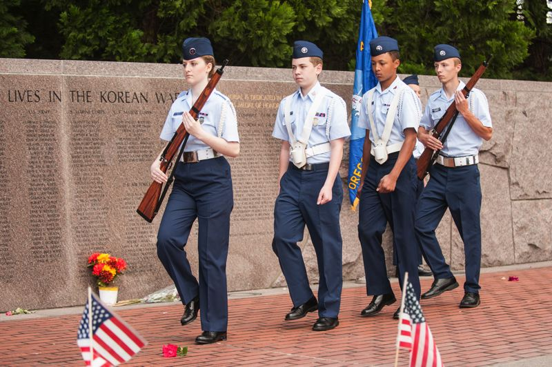 by: SPOKESMAN PHOTO: JOSH KULLA - Aurora Squadron Civil Air Patrol members serve as color guard Monday at a Memorial Day commemoration in Wilsonville.