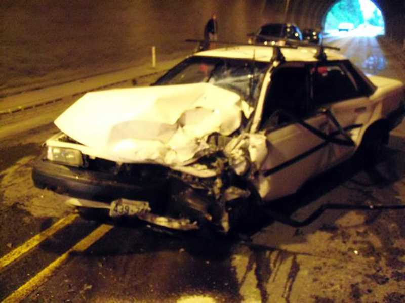 by: COURTESY PHOTO: OREGON STATE POLICE - A 1990 Toyota Camry driven by Washington resident Daniel Calhoon was damaged in a three-car collision on Highway 26 west of Manning on Sunday.
