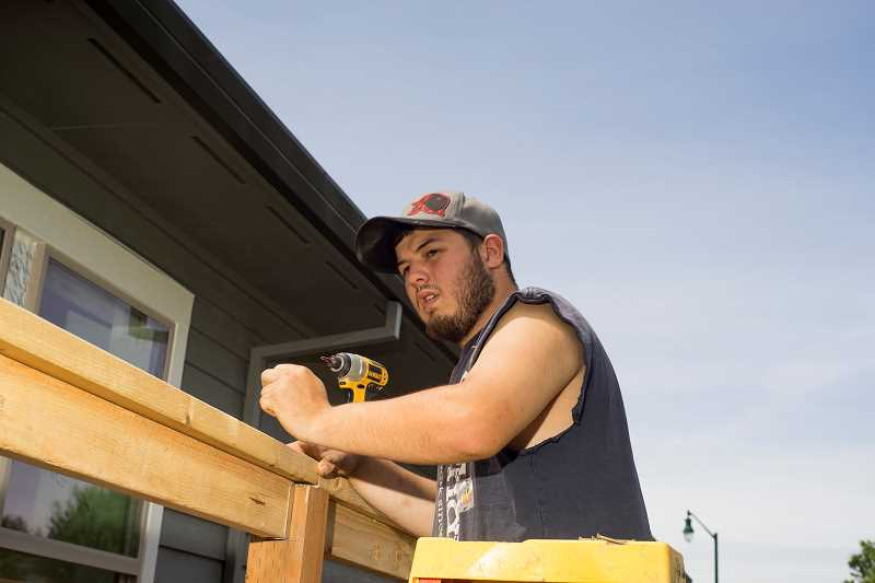 by: NEWS-TIMES PHOTOS: CHASE ALLGOOD - Donald Trent said Cody Fellows was the one who got him interested in Viking House and showed him the value of work. I used to be the lazy one who just hung out with friends. Now, I need to work harder and show his parents and him I can do things I set my mind to.
