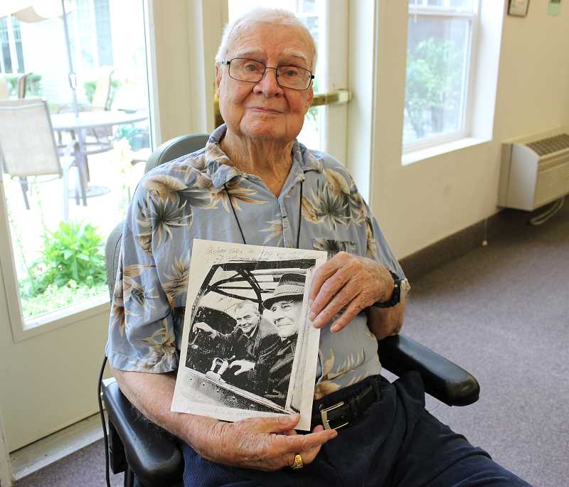 by: NEWS-TIMES PHOTO: KATE STRINGER - James Hattan holds a favorite photo of him and James Doolittle in a B-25 bomber, taken by an Oregonian photographer in 1974. Hattan, 96, lives in the Grove and Gardens assisted living center in Forest Grove.