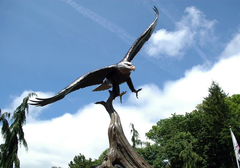 by: ESTACADA NEWS PHOTO: BEVERLY CORBELL - With a 6-foot wingspan, a bronze eagle now flies over Estacada Veterans Memorial