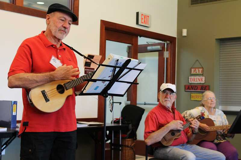 by: TIDINGS PHOTO: PATRICK MALEE - Ron McCallister stepped up to co-lead the Adult Community Center's ukulele club after the original founder moved to California.