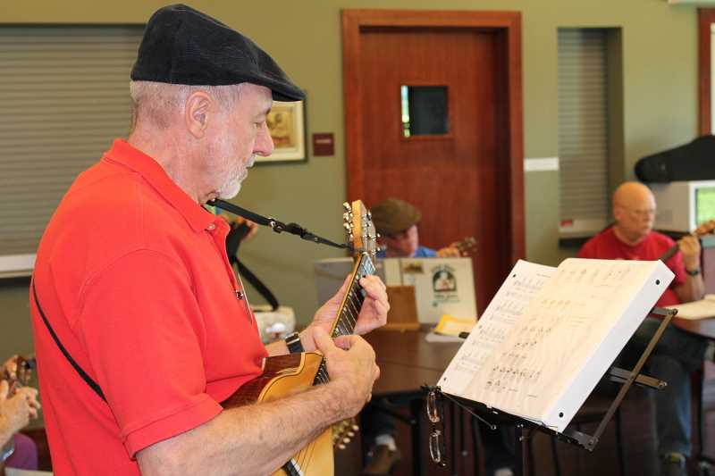 by: TIDINGS PHOTO: PATRICK MALEE - McCallister picked up the ukulele while recovering from triple bypass surgery, and he's been addicted ever since. He sometimes practices three to four hours a day.