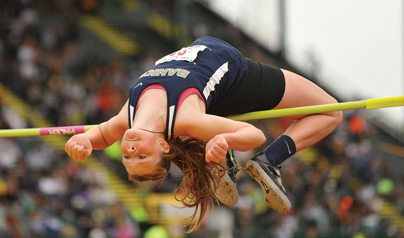by: NEWS-TIMES PHOTO: ZACK PALMER - Banks senior Amy Hilger attempts to clear the bar at 5 feet, 6 inches on Friday at the Class 4A track and field state championships at Hayward Field in Eugene. Hilger won her first state title with a clearance of 5-5.