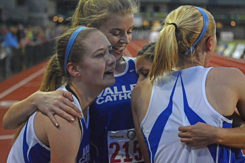 by: TIMES PHOTO: MATT SINGLEDECKER - Valley Catholic's Julia Clark, Hannah Rehm, Makenzee Cleveland and Reilly Blood celebrate their state title-clinching 4x400 relay at the 3A State Championsihp on Friday.