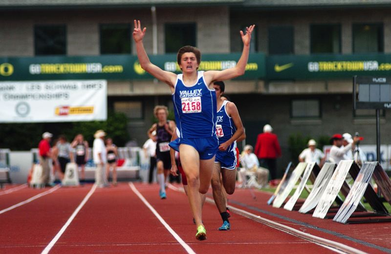 by: TIMES PHOTO: DAN BROOD - Valley Catholic senior Cooper Roach celebrates his come-from-behind win in the 1,500 at the 3A State Championships on Friday. Roach tore his glute during the season, but came back in time for state to beat his teammate and good friend Wilder Boyden.