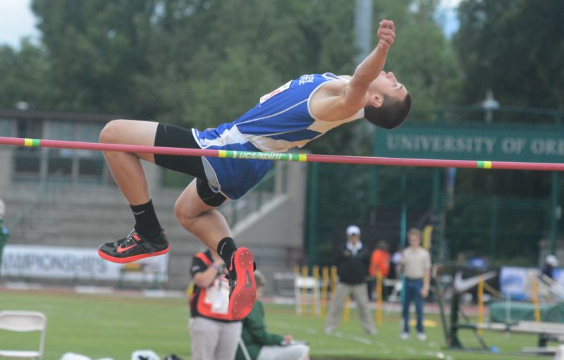 by: TIMES PHOTO: MATT SINGLEDECKER - Valley Catholic senior Jarrett Gray cleared 6-05 in the high jump to clinch the 3A State Championship on Friday. Gray was a rookie this year on the track and field scene.
