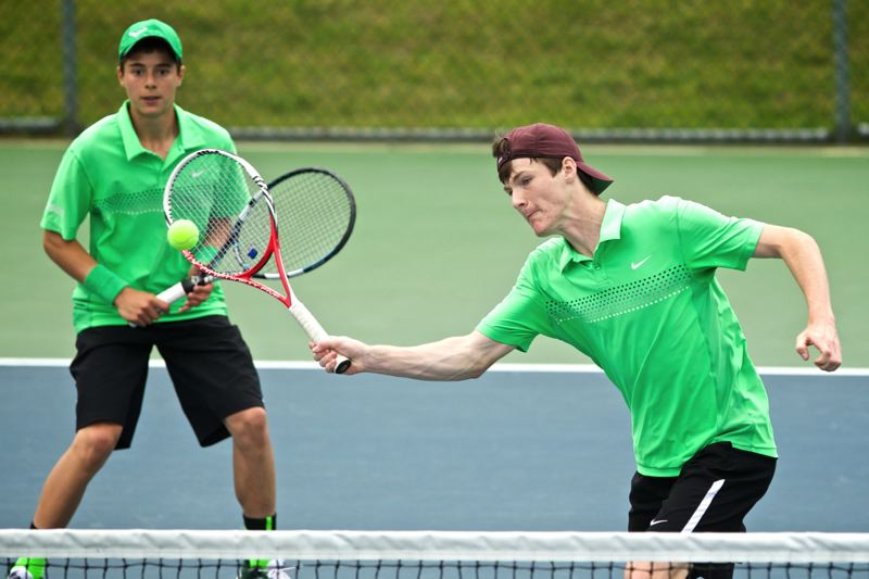 by: TIMES PHOTO: JAIME VALDEZ - Jesuit's Nathan Lortz and Michael Quinn beat Sunsets Jared Lin and Ryan Chin 6-3, 6-4 in the 6A doubles state championship match on Saturday.