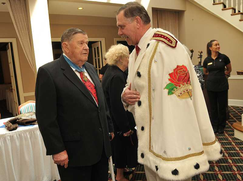 by: REVIEW PHOTO: VERN UYETAKE - Lt. Col. Joe Jackson has received many tributes in recent years. But he wanted to pay tribute to current American military people in Lake Oswego on Tuesday. A Rosarian, right, chats up jackson.