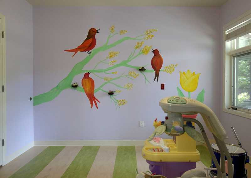 by: TIMES PHOTO: JONATHAN HOUSE - One of the new children rooms at Portland Community Church's new building in Beaverton features colorful art.