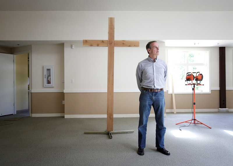 by: TIMES PHOTO: JONATHAN HOUSE - Lead pastor Ron Kincaid of Portland Community Church looks around the still-under-construction sanctuary.
