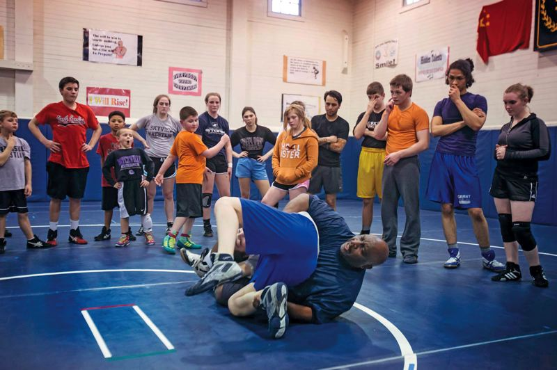 by: TRIBUNE PHOTO: JONATHAN HOUSE - Roy Pittman, who has taught wrestling to an estimated 80,000 Portland-area youngsters during a career of 35-plus years, demonstrates a reversal move at the Peninsula Wrestling Club.