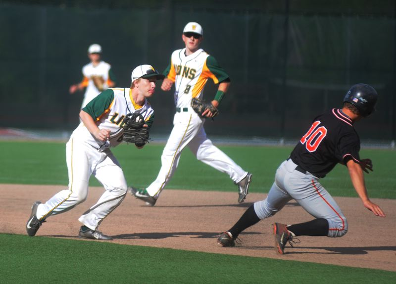 by: MATTHEW SHERMAN - West Linn shortstop Braden Vogt bears down on a Roseburg runner caught in a run-down in Monday's 3-1 playoff victory.