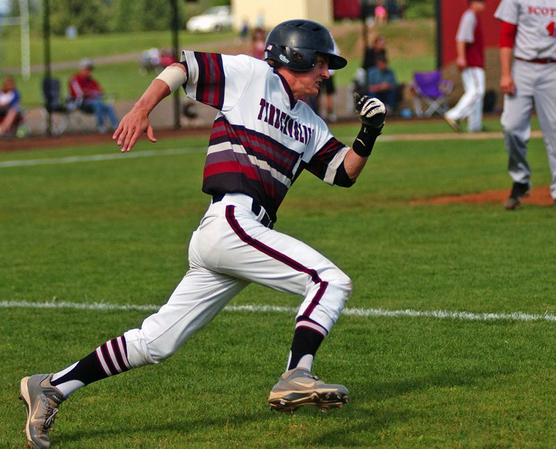 by: DAN BROOD - HIGH GEAR -- Tualatin senior Joey Fishback looks to take a hard turn at first base as he doubled in the first inning of Monday's game.