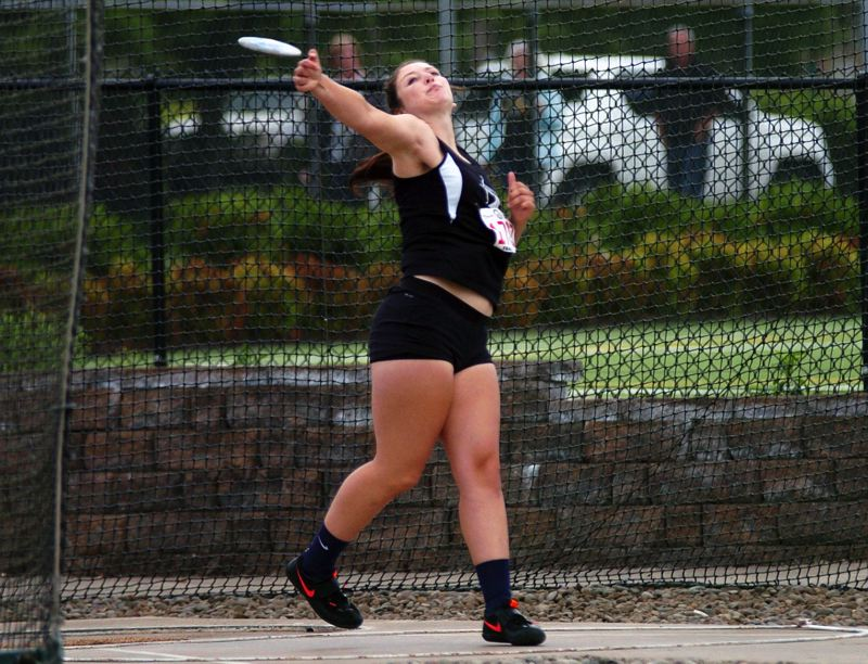 by: DAN BROOD - BIG THROW -- Sherwood senior Elyse Cuthbertson won the Class 5A state title in the discus event with a throw of 124 feet, 8 inches.