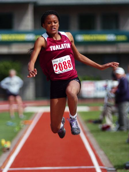 by: DAN BROOD - ALL-OUT EFFORT -- Tualatin High School sophomore Karina Moreland goes for all she can in the triple jump. She ended up placing fifth.