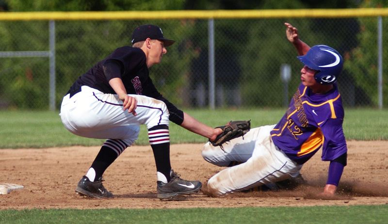 by: DAN BROOD - CAUGHT STEALING -- Sherwood senior shortstop Spencer Clay (left) tags out Hermiston's Nychal Gritz on a stolen base attempt in Wednesday's state playoff game.
