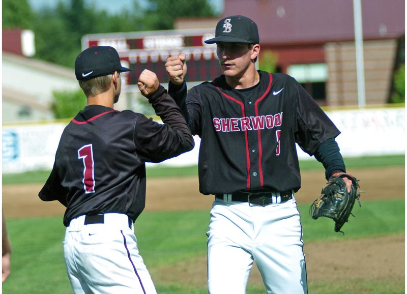 by: DAN BROOD - NICE JOB -- Sherwood senior pitcher Riley Moore (right) is congratulated by senior Beau Curtiss in between innings during the Bowmen's 4-0 state playoff win over Hermiston on Wednesday.