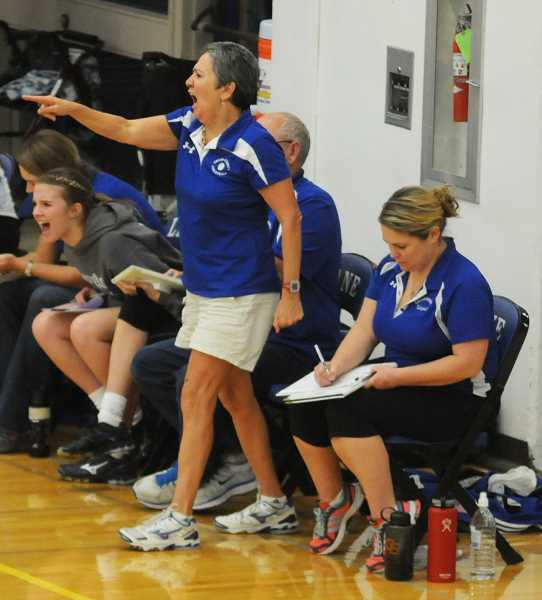 Crook County Head Volleyball Coach Rosie Honl points and yells instructions during the 2013 state volleyball championships, while Assistant coach Kristy Struck calmly keeps stats. The Cowgirls went on to win their eighth consecutive state championship. Honl was recently named Class 4A volleyball coach of the year by the Oregon Coaches association while Struck was one of two assistant coaches froll all classicications and sports honored as assistant coach of the year.