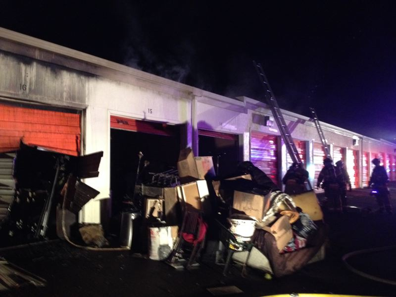 by: PHOTO COURTESY: CLACKAMAS FIRE - Firefighters had to force open the entrance and use special saws to access the arson fire at Public Storage, 11485 S.E. 82nd Ave.