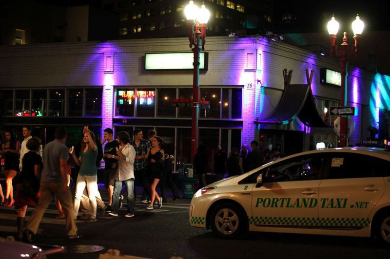 by: TRIBUNE PHOTO: JONATHAN HOUSE - Police want some streets free of cars but nightclub owners are asking the city to remove Entertainment District barricades and allow the clubs more leeway in self-policing the growing summertime crowds in the Old Town area.
