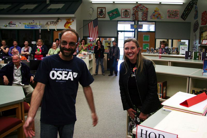 by: COURTESY OF THE OREGON SCHOOL EMPLOYEES ASSOCIATION - Jeanette Sessions (right), head secretary at Lewis and Clark Elementary School, reacts to the announcement she is being honored as the Oregon School Employees Association's Employee of the Year May 5. Christopher Hawkins (left), president of the OSEA chapter for the St. Helens School District, worked with Principal Cathy Carson to nominate Sessions for the statewide award.
