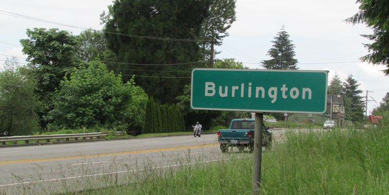 by: MARK MILLER - The sign for Burlington along Highway 30, just south of the intersection with NW Cornelius Pass Road.
