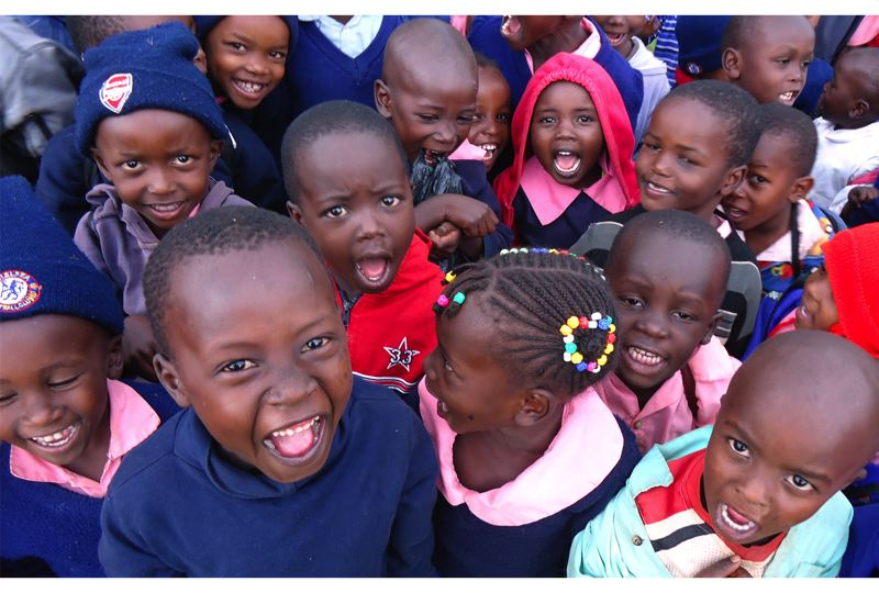 by: CONTRIBUTED PHOTO - Kenyan students play at St. Stephen School Iranda, Portland Lutheran's sister school.