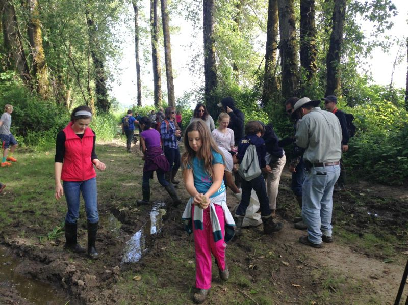 by: PHOTO COURTESY OF ALY FERRIS - Sauvie Island Academy students sow native grass seed on a muddy path near Ruby Lake.