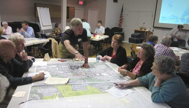 by: BARBARA SHERMAN - LAY OF THE LAND - At King City's first planning charrette May 7, planning consultant Keith Leiden (center) explains the Town Center layout to members of the City Council and Planning Commission, including (from left) Darrel Unruh, Martha Granda and Suzan Turley.