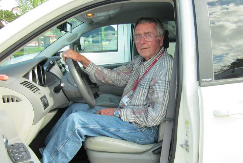 by: BARBARA SHERMAN - KNOWN FOR HIS COURTESY - Sitting in the mini-van he now drives as a volunteer, John Burger was a paid shuttle driver for 10 years beforel switching to the volunteer position in 2012.