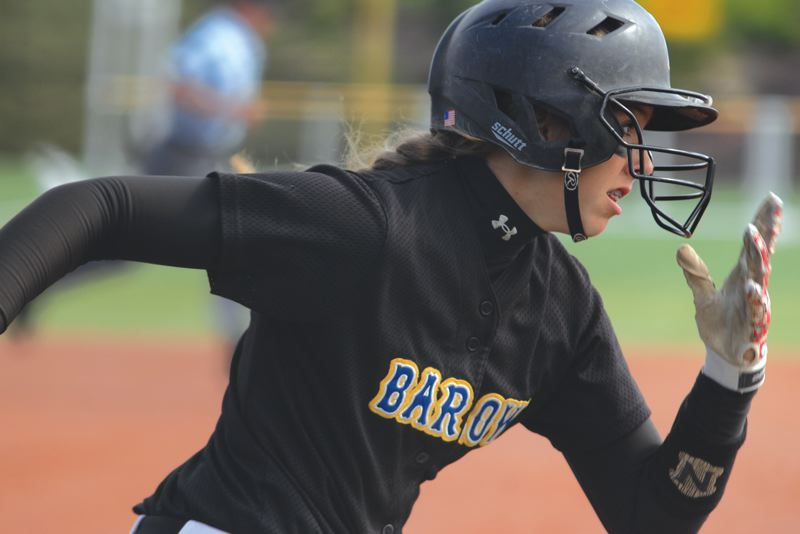 by: THE OUTLOOK: DAVID BALL - Barlows Meagan Bratcher heads down the first-base line after making contact Wednesday. She came around to score in all three of her at-bats.
