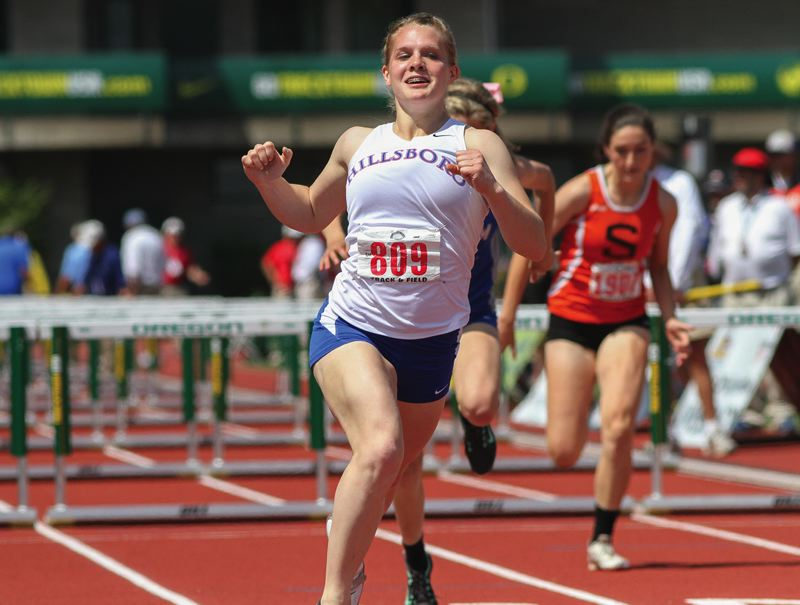 by: HILLSBORO TRIBUNE PHOTO: AMANDA MILES - Hillsboro junior Anna Dean reacts after crossing the finish line Saturday and defending her Class 6A state title in the girls 100-meter hurdles.