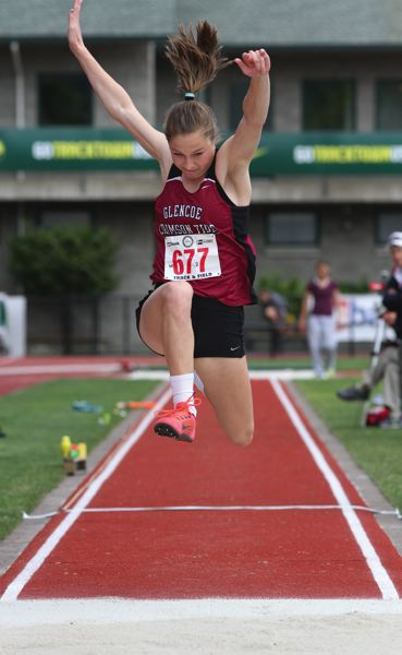 by: HILLSBORO TRIBUNE PHOTO: AMANDA MILES - Glencoe junior Courtney Vacek competes in the girls triple jump competition Saturday en route to a state title at the Class 6A track and field state meet.