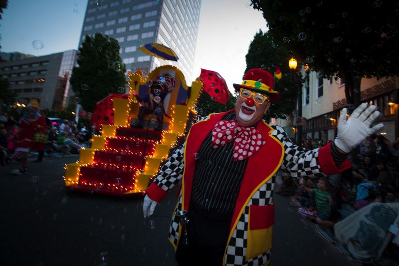 by: TRIBUNE PHOTO: JEFFREY BALL - The Clown Prince and Clown Corps of the Portland Rose Festival looked pretty funny during Satuday's Starlight Parade.