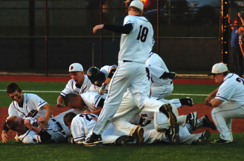 by: SANDY POST: PARKER LEE - Sandy players dogpile in the center of the field after Fridays 3-2 win over Marist in the 5A quarterfinals.