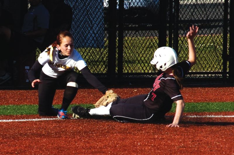 by: SANDY POST: PARKER LEE - Sandys Alexandra Moss slides into third base with an attempted steal during Fridays 1-0 playoff loss to St. Helens.