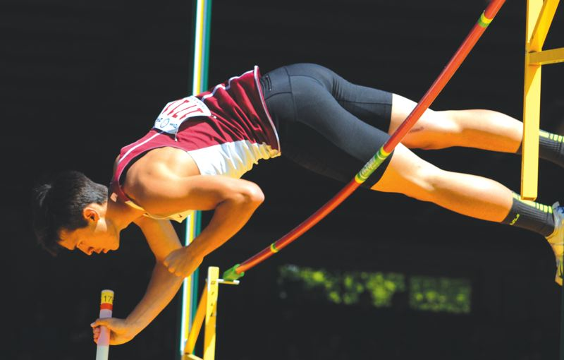 by: SANDY POST: DAVID BALL - Sandys Kaden Walker goes over the bar at 13-feet-9-inches during his fifth-place effort in the pole vault.