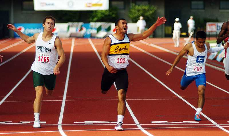 by: DAN BROOD / PAMPLIN MEDIA GROUP - Devon Fortier (center) crosses the finish line of the boys 200-meter dash May 24 during the Class 6A state track and field championships at Hayward Field in Eugene, edging Sheldon's Mitch Horning (left).
